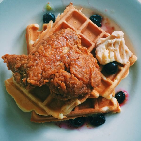 classic buttermilk fried chicken & waffles w honey butter and blueberry maple syrup